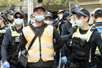 'Thuggery': Flares lit, traffic blocked as protesters move through Melbourne CBD