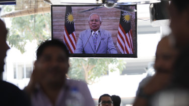Malaysian PM Najib Razak is seen on television announcing he obtained consent from Malaysia's king to dissolve Parliament.
