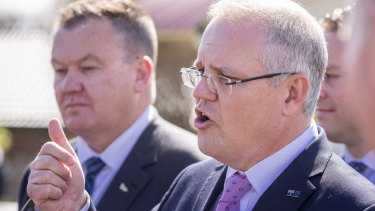Prime Minister Scott Morrison faces the media at Leawarra Railway station in Frankston, Melbourne, on Friday.