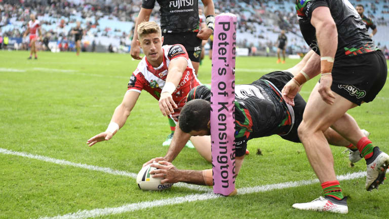 Tough start: Greg Inglis crosses in the corner to welcome Zac Lomax (background) to the top grade.