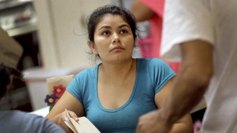 Carla, a migrant mother from El Salvador, waits with other parents in detention in Texas to be reunited with their children.