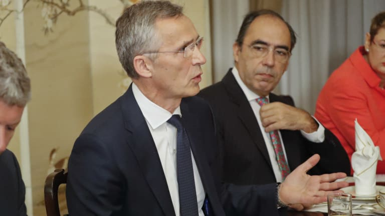 NATO Secretary General Jens Stoltenberg, gestures while speaking to US President Donald Trump.