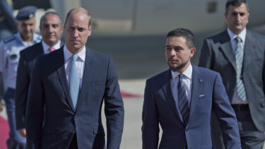 Jordanian Crown Prince Hussein, right, receives Prince William at Marka Airport in Amman.