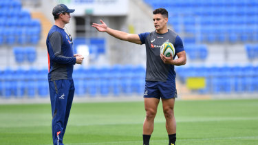 Inside knowledge: Stephen Larkham and Matt Toomua work on their game plan for the Pumas.