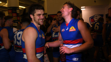 Dogs are barking: Bulldogs players Bailey Williams and Aaron Naughton celebrate their team's biggest win of 2019.