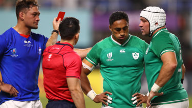 Ousted: Referee Nic Berry shows Bundee Aki a red card as Ireland captain Rory Best  and Samoa skipper Jack Lam look on at Fukuoka Hakatanomori Stadium.