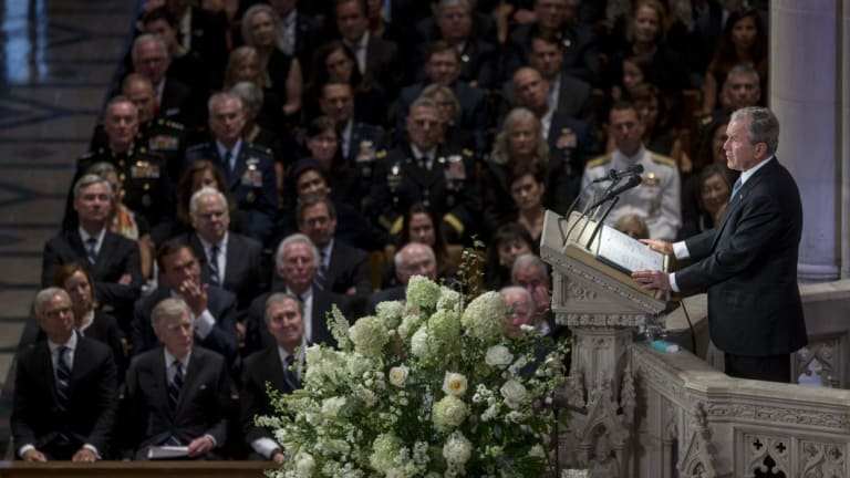 Former US president George W. Bush speaks during the memorial service for late Senator John McCain at Washington National Cathedral in Washington, DC,  on Saturday.