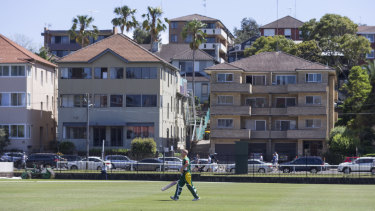 Humble surrounds: David Warner walks back to the pavilion after being dismissed for 13.