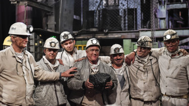 Miners hold the last lump of coal during a closing ceremony of the last German coal mine Prosper-Haniel in Bottrop on December 21, 2018.