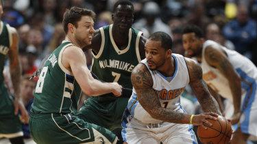 Milwaukee's Matthew Dellavedova (left) is heading back to Cleveland.