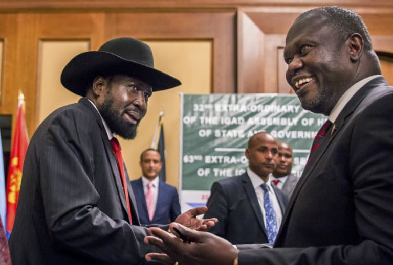 South Sudan's President Salva Kiir and opposition leader Riek Machar shake hands during peace talks in Addis Ababa, Ethiopia in June.