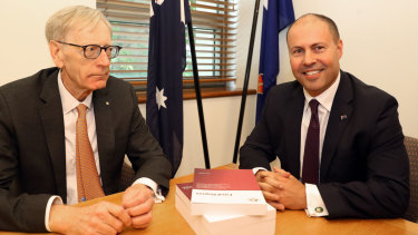 Pretty uncomfortable: Commissioner Kenneth Hayne and Josh Frydenberg at their extremely awkward photo opportunity on Friday.