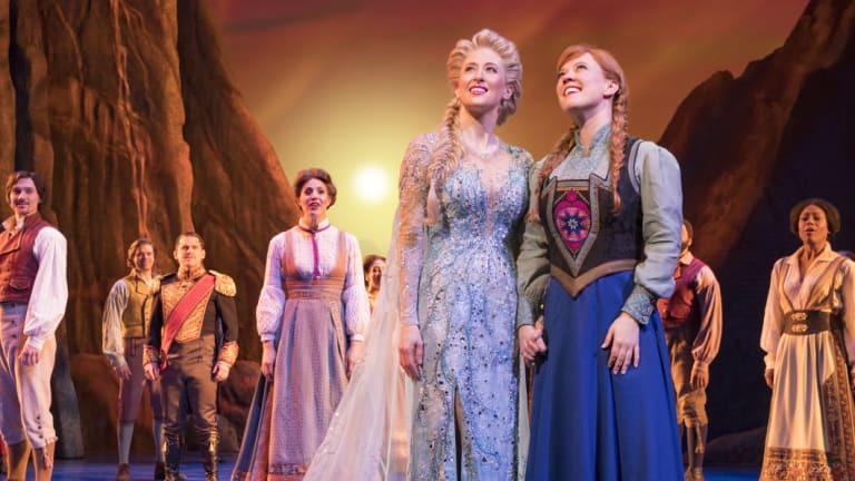 Caissie Levy (Elsa), Patti Murin (Anna) and the company of Frozen on Broadway.