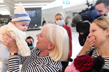 The Age, News, 19/04/2022, photo by Justin McManus First flights in the Australia and New Zealand travel bubble. Grandmother Janet Callaghan meets grandson 3 month old Finn for the first time with along with Janet's daughter Jo Mangos.