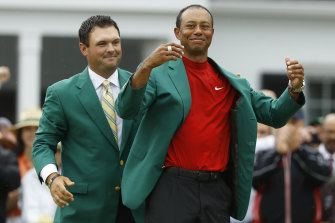 Tiger Woods dons his fifth green jacket following his remarkable win at Augusta National last year.