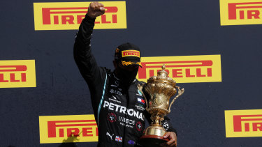 Mercedes driver Lewis Hamilton on the podium after winning the British Formula One Grand Prix at Silverstone on Sunday.
