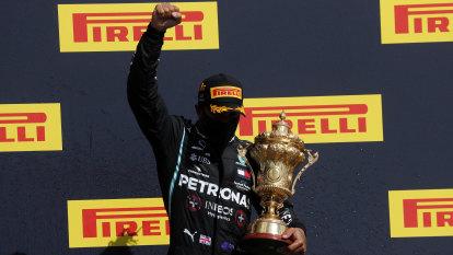 Hamilton wins record seventh British GP despite late puncture