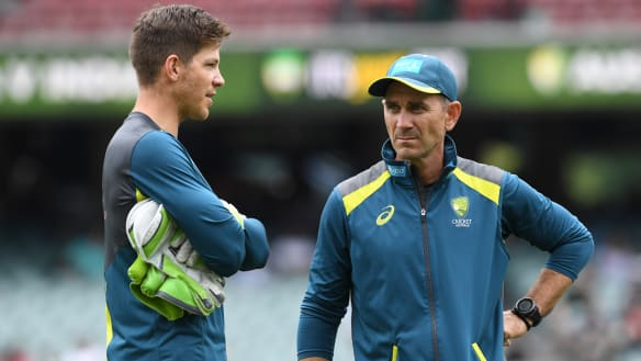 Tim Paine speaks with Justin Langer ahead of play on day three of the first Test match between Australia and India.