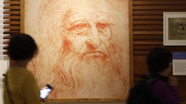 Visitors pass a portrait of Leonardo da Vinci in Rome on the 500th anniversary of his death.