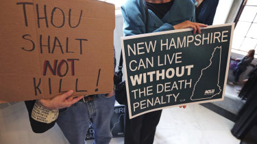 Protestors make their case ahead of the vote in New Hampshire. which has become the latest state to abolish the death penalty.