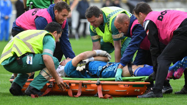 Casualty: Filip Kurto is carried from the field after clashing with Andy Keogh.