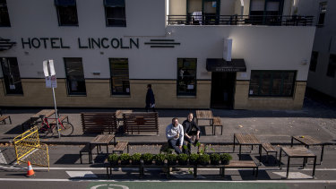 Publican Iain Ling (L) and RMIT urban design researcher Thami Croeser in a car space outside Hotel Lincoln that could be used to serve patrons.