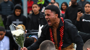 Victoria University Secondary College school captain Poasa Telepe performs the haka during a memorial for Solomone Taufeulngaki outside Brimbank Shopping Centre on Friday evening.