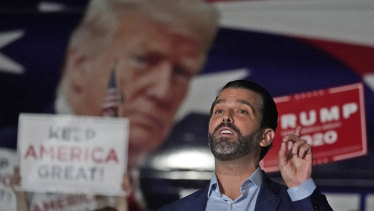 Donald Trump jnr, gestures during a news conference at Georgia Republican Party headquarters.