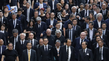 Hundreds of legal professionals wear black to express their disappointment as they participate in a silent march to protest against the extradition bill in Hong Kong.