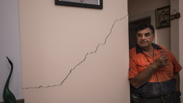 Umberto Galasso pictured with a crack he says opened up or widened after excavation works for WestConnex beneath his North Strathfield home.