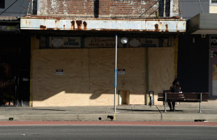 Boarded up: the old Olympia milk bar on Parramatta Road at Stanmore.