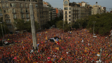 Pro-Independence demonstrators pack the Avenida Diagonal during the Catalan National Day in Barcelona, Spain.