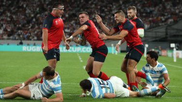 Gaining momentum: George Ford celebrates after scoring against Argentina at Tokyo Stadium.