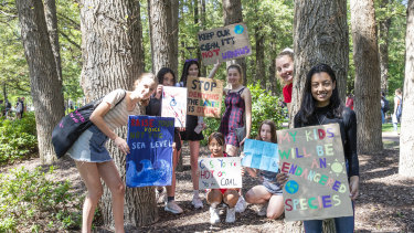 Climate strikers Emily Thomson, 14, Christina Hood, 14, Astrid Smyth, 14, Sarai Khin, 14, Lily Saxon, 14, Matilda Von Garvel, 14, Autumn Starbird and event organiser Maanha Manzur, 14.