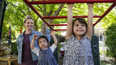 Kaitlin Gonzalez, a university student and childcare worker, with children at a Sydney long daycare centre.