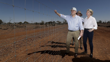Prime Minister Scott Morrison, is joined by colleagues David Littleproud and Bridget McKenzie inspect a dog-proof fence at Quilpie during a drought tour in south-west Queensland.