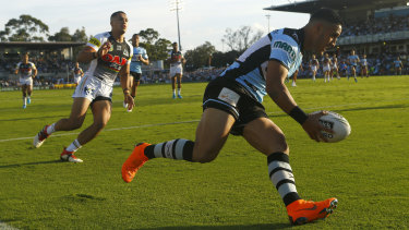 Super finish: Valentine Holmes crosses for the Sharks at Southern Cross Group Stadium.