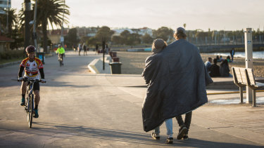 Brothers Bela and Noah from the Netherlands wander along St Kilda beach at dawn.
