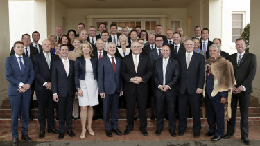 Prime Minister Scott Morrison poses for photos with his new-look ministry.