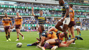 Shaun Lane goes over as the Eels pile on the points.
