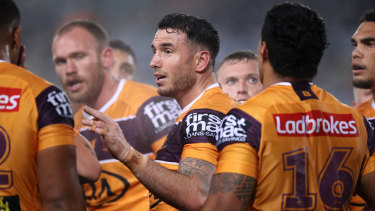 Darius Boyd talks to his Broncos teammates.