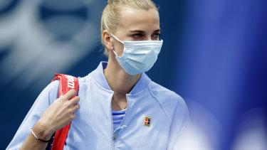 A masked Petra Kvitova enters the court before her match against Karolina Muchova.