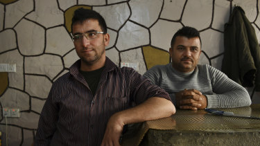 Brothers Raman*,35 (left), and Aram*, 31 in their kebab shop in Basirma refugee camp in Iraqi Kurdistan.