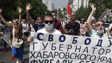 """People hold posters reading """"Freedom for Khabarovsk region's governor Sergei Furgal"""" during an unsanctioned protest."""