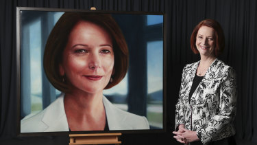 Former Prime Minister Julia Gillard with her official portrait painted by Vincent Fantauzzo.