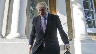 Boris Johnson leaves his home on Tuesday.