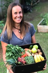 Kate Nielsen with one of the boxes that have helped farmers sell their produce.