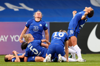 Millie Bright and Sam Kerr celebrate with Fran Kirby after Chelsea's late goal.