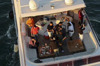 Tourists party on a yacht in Dubai last week. Since becoming one of the world's first destinations to open up for tourism, Dubai has promoted itself as the ideal pandemic vacation spot.