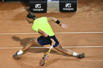 Spain's Rafael Nadal returns the ball to countryman Pablo Carreno Busta during their second round match at the Italian Open.